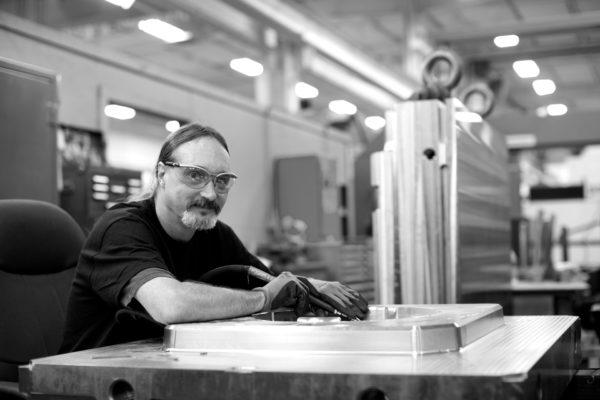 man welding in a warehouse